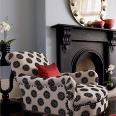 oversize studding on chair mimicked in miror design