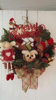 One of my fantasy Christmas wreaths  . Love putting cheeky whimsical things in them .. ( made by me )