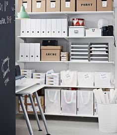 Wall shelves filled with magazine files, boxes, letter trays and waste sorting bags