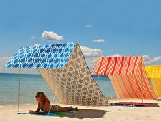 Seek shelter from the sun under a modern canopy. Beach Tents from Sombrilla, The Grommet