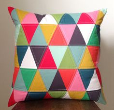 color carnival II  18x18 small triangle pillow by paisleysprouts...fun and funky for the playroom!