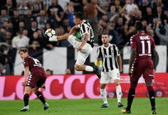 Paulo Exequiel Dybala (2L) of Juventus in action during the Serie A match between Juventus and Torino FC on September 23, 2017 in Turin, Italy.