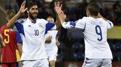 Cyprus' forward Nestor Mytidis (R) celebrates with Cyprus' defender Charalambos Kyriakou