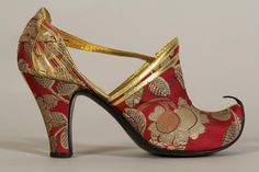 Red brocade shoes with turned up toe. French, 1930s,   Collection of the Kent State University Museum KSUM 1983.1.1691ab