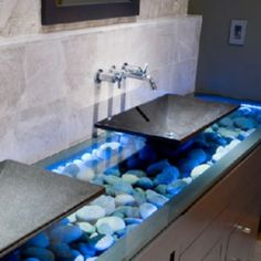 Great effect with the stones and light underneath glass... Other such magnificent ideas for decorating your bathroom can be found at http://www.bathroom-paint.net/