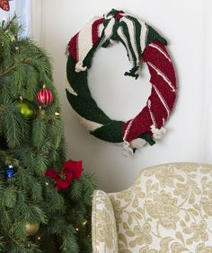 Warm your holiday décor by wrapping these colorful scarves around a wreath form to create a lovely decoration. Metallic thread in the RED HEART® Holiday® yarn adds glitter to traditional holiday colors. All Things Christmas, Christmas Holidays, Christmas Wreaths, Christmas Crafts, Christmas Ideas, Holiday Ideas, Xmas, Winter Holiday, Holiday Decorations