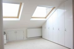 Fitted wardrobes on sloping roof wall in loft conversion