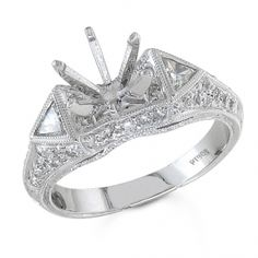 BF1368 - #23504  18 k, white diamond ring 0.49 ct. rounds 0,18 ct. triangle (Please call for pricing)