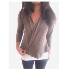 """Banana Republic Taupe Brown Draped Cardigan This cardigan is stretchy with quarter inch style sleeves & a draped front. Despite my best efforts the color is slightly off in pics, but the color is a dark taupe brown, {actual color of item may vary slightly from photos}  •shoulders:16"""" •chest:19"""" •waist:19.5""""w •length:21.5"""" •sleeve:18""""  Material:95% rayon 5% spandex  ️machine wash  Fit:true/might work for sml Condition:no rips no stains light balling & light writing on interior ❌no holds ❌no…"""