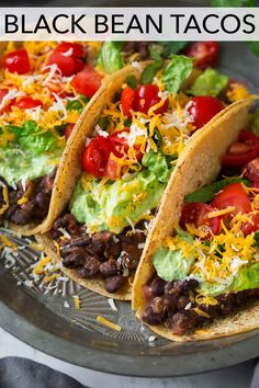 The BEST Black Bean Tacos - These are the fastest, easiest tacos! Canned black beans are briefly simmered with salsa, spices and garlic then layered over tortillas and finished with a bright lime crema and your favorite toppings. It's a vegetarian recipe everyone will love! #blackbean #tacos #recipe #mexicanfood #healthyrecipe Veggie Recipes, Mexican Food Recipes, Dinner Recipes, Cooking Recipes, Healthy Recipes, Paleo Dinner, Cilantro Recipes, Beans Recipes, Cooking Food
