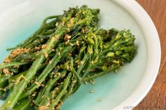 1 lb. broccolini 3 cloves garlic, minced 1/2 Tablespoon chili flakes 3 Tablespoons oil 3 Tablespoons tamari or soy sauce Instructions Preheat the oven to 375º and line a baking sheet with parchment. Wash broccolini thoroughly. Spread the broccolini out on the baking sheet and drizzle with oil and tamari. Evenly sprinkle garlic and chili flakes. Roast for 15 minutes in the oven.