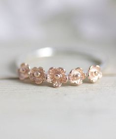 Sterling silver flower statement ring with rose gold ring embellishments perfect for the holidays.