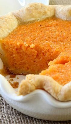 Mary Randolph's Sweet Potato Pie This recipe masterfully combines brandy, lemon juice, lemon zest, vanilla extract and sweet potatoes into a pie that is positively bursting with flavor! It will change the way you look at sweet potatoes forever! Köstliche Desserts, Delicious Desserts, Dessert Recipes, Yummy Food, Vegan Sweet Potato Pie, Sweet Potato Recipes, Mississippi Sweet Potato Pie Recipe, Sweet Potato Cobbler, Pie Recipes
