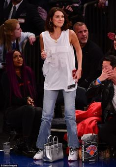 Outfit change? She was later seen changing into a loose New York basketball vest