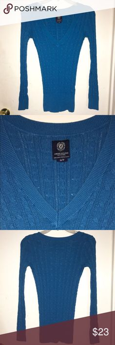AMERICAN EAGLE Turquoise Sweater V Neck Beautiful Turquoise Blue American Eagle Sweater! In Excellent Pre-Loved Condition, Mild Washwear. See pictures for details & Measurements, let me know if you have any questions! Don't forget to look at my other items, Bundle & $ave 💕 American Eagle Outfitters Sweaters V-Necks