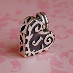 A sterling silver monogram keepsake to celebrate a new addition to  your family or a new union in your life.