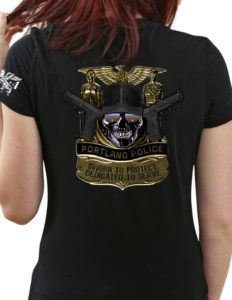 Portland Police Bureau Women's Shirt is a subdued LEO shirt design that illustrates the strength and determination of fighting criminals and lawlessness.