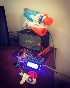 Complete. Now any time one of our users on Collaborizm makes a post my #nerf #electric #water #gun shoots for 5 seconds and my #mascot #rex  spins for 5 seconds. So much fun. Thanks to #collaborizm @harsha.alva amazing #maker projects can come to life flawlessly. #raspberrypi3 #arduino #motorshield #dc #power #hack #data #desk #toy #design #hardware #electronics #create #build #science #art #math #node #javascript #robotics #swag #raspberrypi