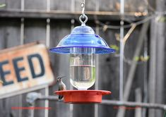 #homeliving #outdoorgardening #feedersbirdhouses #hummingbirdfeeder #beeproof #nodrip #birdfeeder #dripfree #besthummingbird #gift #easyclean #birthdaygift #hummingbird #glassart #hummingbirdfeeder #blueglass #hangingbirdfeeder #handmade #glassmasonjar #feedingbirds #giftforwife #cottagecore #outdoors #birdhouse #easytohang #birds Wild Bird Feeders, Hanging Bird Feeders, Glass Dispenser, Drip Drip, Clear Stickers, Glass Birds, Pyrex, Hummingbird, Glass Art
