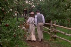 Anne and Gilbert in the apple orchard.
