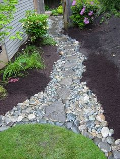 Pathway idea from driveway, also allows for water to run off