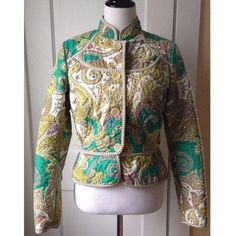 "ETRO MILANO Quilted Paisley Jacket This gorgeous jacket by the Italian fashion house ETRO Milano boasts luxury design and craftsmanship. Green, gold, cream and purple quilted paisley fabric. Flattering trim, 2 slip pockets, 4 buttons, and a Mandarin collar. Body and fill: 100% polyester, lining: 100% cotton. ❗️SIZE NOTE Italian size 44 = US size 10 BUT THIS JACKET FITS LIKE US SIZE 6❗Modeled on a dress form with the following measurements: 35""(bust) 26""(waist) 32""(hip). Dry cleaned and in…"