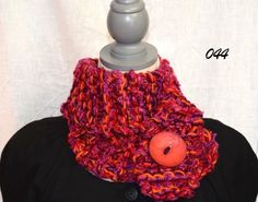 Hand knit from 3 to 6 strands of various yarns, our scarves keep you cozy and warm. They can be hand washed and lay flat to dry. Over the course of time they will stretch, so you can wear them looser or wrap them one more time. We have some scarves with wool in them, so we have marked those as we know some people don't like or can't wear wool.