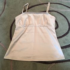 SALE Stretchy satin cami Light tan/beige color. Stretchy and great for layering. Looks great under a cardigan or a suit jacket.                                                                     🛍 New York & Company Tops Camisoles