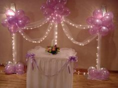 purple balloon columns and tulle with lights