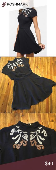 UO Pins & Needles Embroidered Dress XS UO Pins & Needles Embroidered Dress XS  EUC - no rips, stains, damage. LIKE NEW!  Beautiful mini dress, high neck with embroidery detailing, skater skirt and flirty open slot on the back. Pins and Needles Dresses Mini