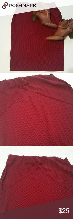 NEW LISTING--NWT Maroon Chevron skirt Dress it up or dress it down, this is a pencil skirt for any occasion! Two-tone maroon chevron stripes, criss-cross detail on the front, elastic waist...it's beautiful, perfect and NEW WITH TAGS! Pics show the skirt more red than it really is. The skirt is more of a true maroon/wine color. Maurices Skirts Pencil