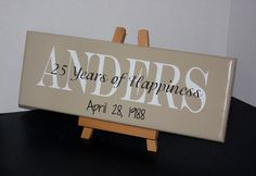50th Wedding Anniversary or 25th Wedding Anniversary Personalized Family Name Wood Sign with Established Date. $29.95, via Etsy.