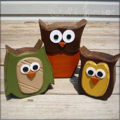 "awww...owls! cute little woodland owls decorated in the fall colors of green, brown, yellow, tan and orange. They have each been hand cut from 2"" pine then painted, sanded and stained for a distressed look. These little owls would make a great addition to any fall home decor!"