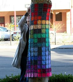 "Yarnbombing a tree - ""Tetris Psychedelia,"" by Rett Grayson"