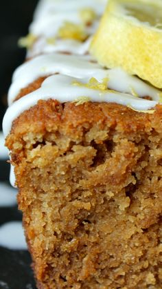 Lemon Drizzle Cake ~ A tender, melt in your mouth loaf cake with the fresh zest and juice of lemon, glazed w/ coconut butter, and zested w/ extra lemon.