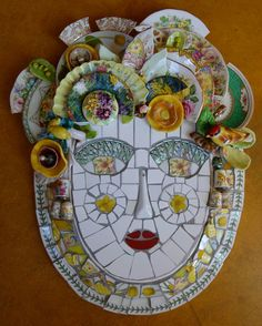 This is my first commission (Oct '14). Jan gave me some pieces of sentimental crockery that she wanted included in a yellow face which is to hang in her garden.