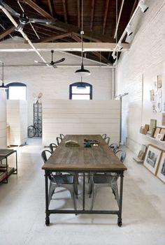 white floor, painted brock, Mirais chair, schoolhouse lamps, exposed beams, industrial table, #office