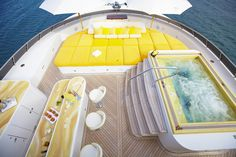 This stainless steel Bradford Yacht Spa features custom Crag Bragdy tile. The yellow hues of this luxury hot tub match the deck's overall theme. The blue accents in the bottom of the tub mimic the color of the ocean, providing an exciting contrast to Bragdy's one-of-a-kind yellow tile.