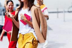 Bright leather pants and clutch paired with plain white T and neutral blazer