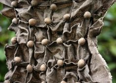 shibori in process – soy beans wrapped and tied and some pulled running stitches - by Lotta Helleberg
