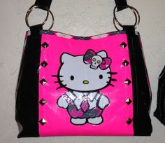 Punk style Hello Kitty cut out of duct tape, on a studded duct tape purse!