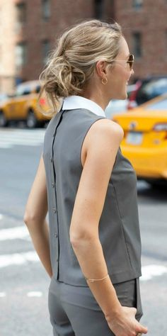 olive green matching set: sleeveless crop top with detachable collar and back button detail, cuffed crop wool pants + messy bun hairstyle {theory, work wear, suit alternative}
