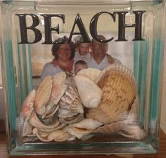 I get a lot of repins on this so I added a picture of the finished product. The extra shells found at the beach and a picture of the family on the beach. Stickers and glass block found at hobby lobby.
