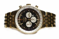 FOR A LIMITED TIME - Ends On 2017-02-21 12:00 (GMT) - GENTLEMAN'S BREITLING NAVITIMER EIGHTEEN CARAT GOLD AUTOMATIC WRIST WATCH the round dial with GENTLEMAN'S BREITLING NAVITIMER EIGHTEEN CARAT GOLD AUTOMATIC WRIST WATCH the round dial with applied gold coloured baton hour markers, date aperture, subsidiary dials at 3, 6 and 9, 44mm case, on an eighteen carat gold bracelet strap with fold over clasp, 53.5g gross, in box, with outer box and papers Keywords: Auction, breitl