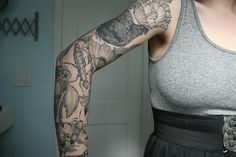 Nature sleeve: flowers, bugs, feathers, and a hen! I admire this art A LOT.