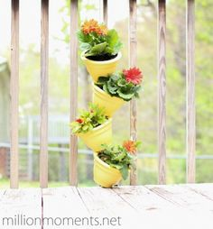 How To Make A Simple Vertical Garden - Love the Yellow Pots with Gerber Daisies