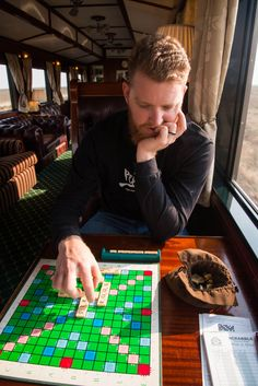 Passing the time by playing Scrabble and relaxing. Rovos Rail - Cape Town to Pretoria. Victoria Falls, Pretoria, Scrabble, Cape Town, South Africa, Safari, Train, Luxury, Holiday