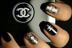 Chanel inspired design on natural finger nails