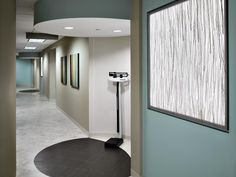 soft blue/beige color scheme; lit in-wall art  - LeVino Jones Medical Interiors, Inc.