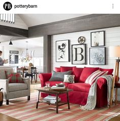LOVE this red sofa from Pottery Barn!   The wall art is pretty cool as well.